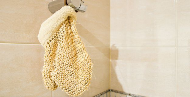glove hanging in shower to dry