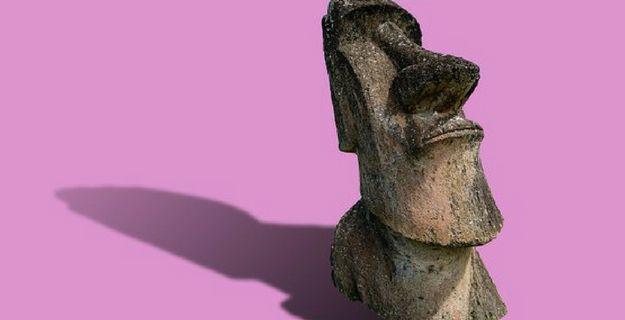 wooden tiki head, pink background