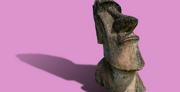 wooden tiki head, pink background