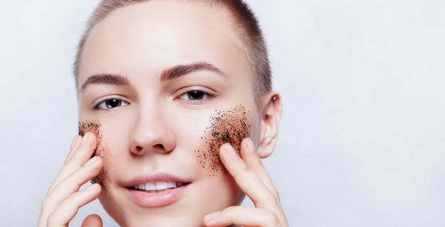young woman applying diy coffee scrub